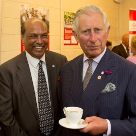 Photograph of Raj with HRH The Prince Of Wales at Princes Trust Wales 40th anniversary .