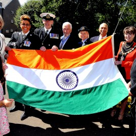 70th India Independence Day Flag raising celebration at Cardiff's Mansion House. Nini Aggarwal (7) helps with the flag raising with: (l-r) Morfudd Meredith Lord Lieutenant of South Glamorgan, Belinda Davies Chief Superintendent Cardiff South Wales Police, Tim Street Warrant Officer Royal Navy, John Williams High Sheriff South Glamorgan, Jill Pritchard Squadron Leader Royal Aux. Air Force, Raj Puri Guest speaker from Los Angeles, Georgina Phillips Deputy Lord Mayor of Cardiff, Raj Aggarwal Indian Hon. Consul for Wales.